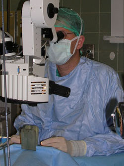 Ophthalmology surgeon observing through a microscope